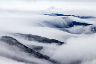 clouds rolling over mountain crests | by angelatravels11