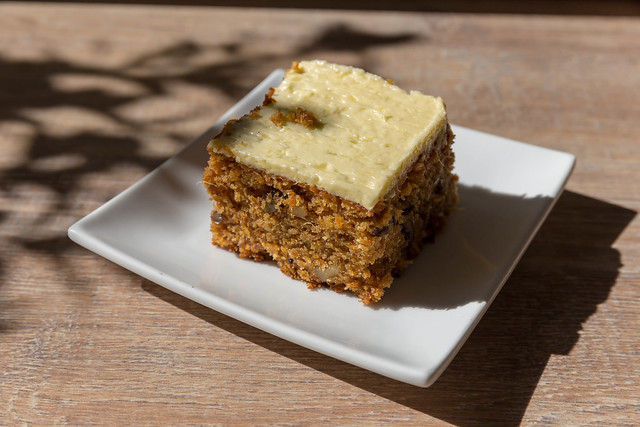 Nut cake with white chocolate topping on square plate