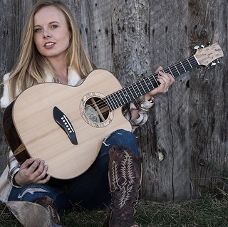 Eric Osmann Guitars . Karagan Osmannn is showcasing my latest cutaway steel string guitar - 50year aged Stika Spruce top with Indian rosewood back and sides. Ebony fretboard and bridge. Spalted Maple rosette and headstock. . . . #guitar #guitars #guitarbu