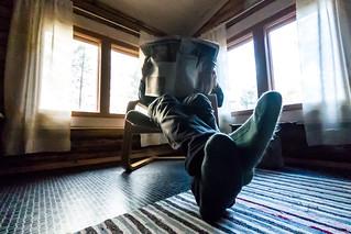 reading newspaper in a cottage | by VisitLakeland