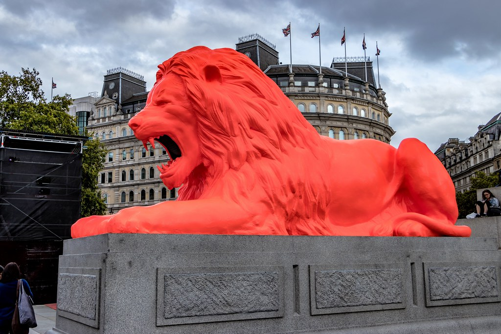 A giant fluorescent Lion had joined the four other big cats on trafalgar square. The bright red lion which roared poetry had been installed as part of the London Design Festival and was made by set designer, Es Devlin.