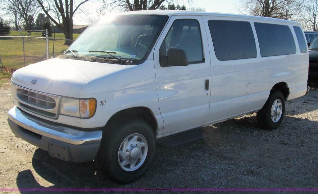 fa0c59eadb Oxford White 2002 Ford E-350 Super Duty XLT 15-Passenger Van.