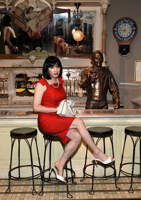 Wearing my life size Barbie Sheath Sensation dress at the Coca Cola museum in Atlanta GA