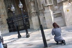 crouching tourist