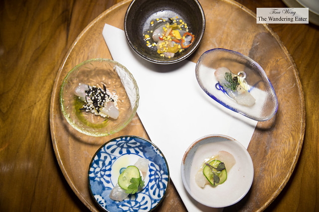 Sea bass sashimi, tasting of five spoons - wasabi, creme fraiche with cucumber, hijiki and puffed rice, fish sauce bee pollen & chii, soy sauce and seaweed