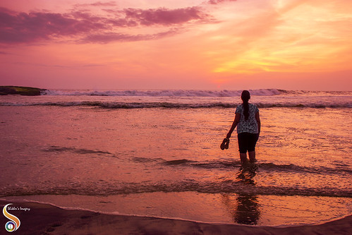kerela kovalam beach shore waves horizon sunset sun sky radiance clouds sand amber lady woman costal coast seashore shikhersimagery