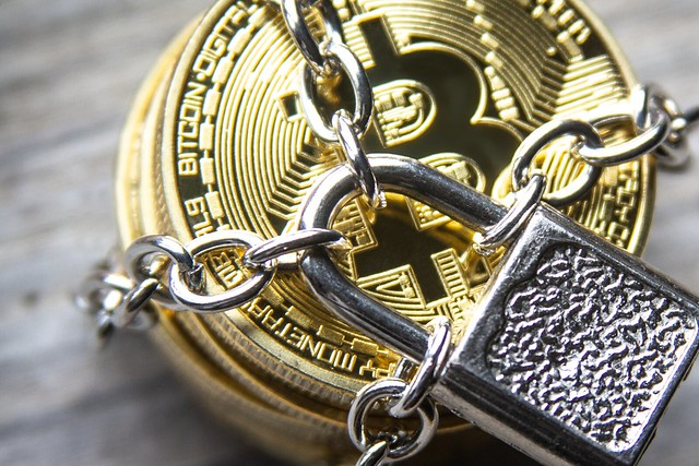 Secure Bitcoins locked with padlock and chain