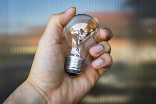 Close-Up Of the Hand Holding the Light Bulb | by wuestenigel