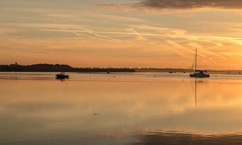 langstone sunrise reflections boats