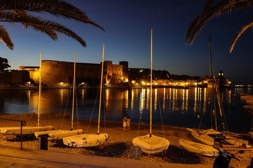 collioure france château royal castle fort boats palm sea night sky beach