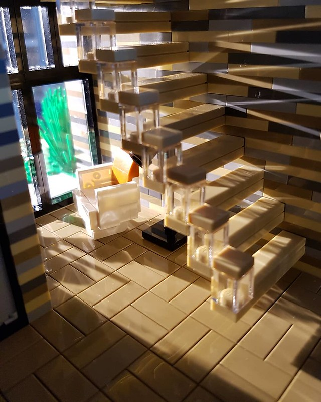 Lilium Eco House MOC. Chair in sunlight.