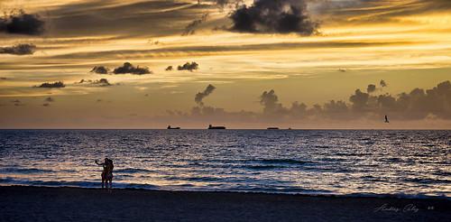 earlyinthemorning sunrise seashore seascape sea skies colors clouds people beautifulpeople beach beachscape beachshore waterways walking walkingaround outdoors