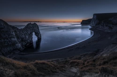 photographybyjuliamartin durdledoor dorset lowlightphotography seashore twilight dusk naturallimestonearch jurassiccoast