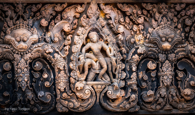 What is This Character at Banteay Srei Temple Doing? (see below) Angkor, Cambodia-54a
