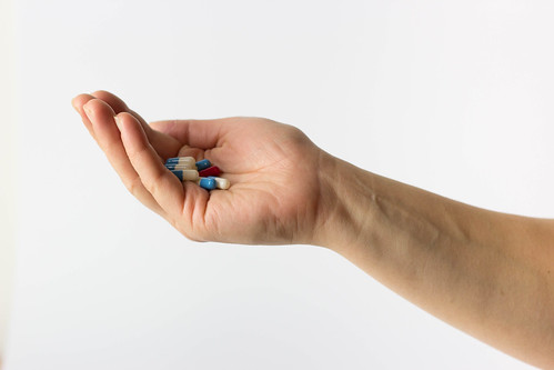 Pills in Opened Hand | by focusonmore.com