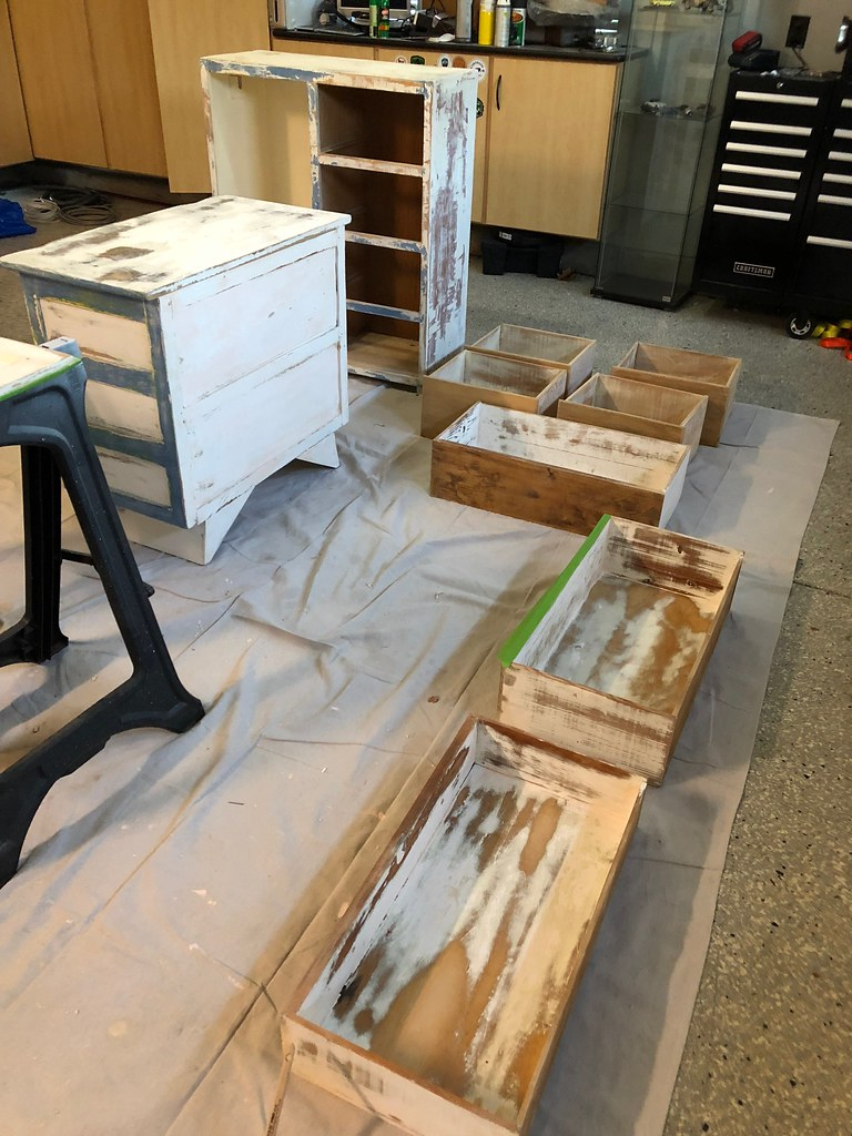 Sanding and painting the nursery furniture