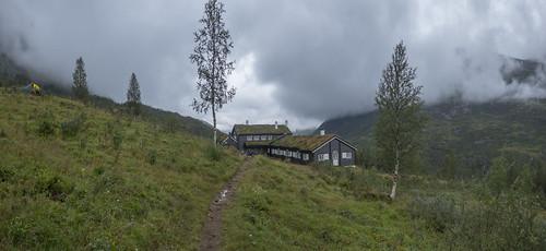 norway dnt hut fannarak hiking mountain high cloud panoramic views sunset snow