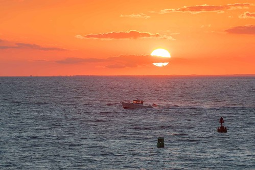 theknob woodshole massachusetts sunset water boat buoy ocean clouds seascape quissettharbor atlantic capecod gseloff