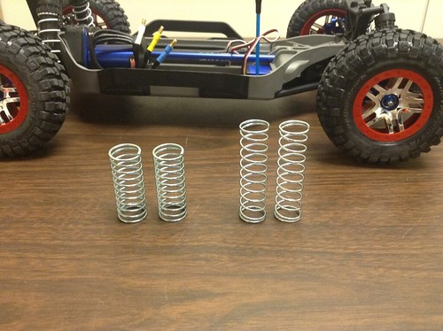 """The taller springs (2.5""""/2.75"""") are used in the back while the shorter springs (2"""") are used in the front."""