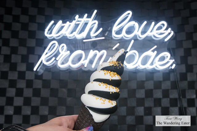 Mixed Feelings - Activated charcoal wih pineapple swirled with vanilla soft serve topped with edible gold sprinkles in black cocoa waffle cone
