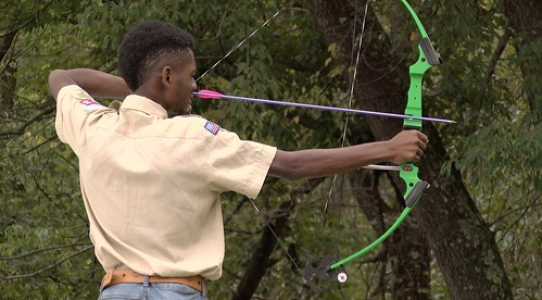 Photo of man shooting an arrow during National Fishing and Hunting Day