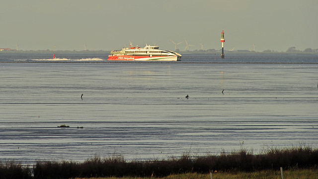 A speed ferry catamaran with Jet drive coming from Helgoland island towards Cuxhaven and Hamburg harbours