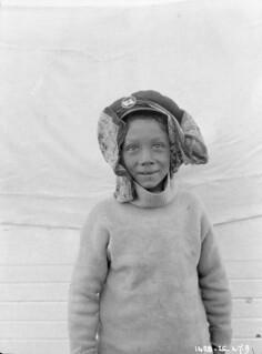 Young boy in a sweater smiling. Possibly Pigatyak, the father of Jack Kabvitok, Igluligaarjuk, Nunavut /  Jeune garçon souriant, vêtu d'un chandail. Il s'agit possiblement de Pigatyak, père de Jack Kabvitok, Igluligaarjuk (Nunavut)