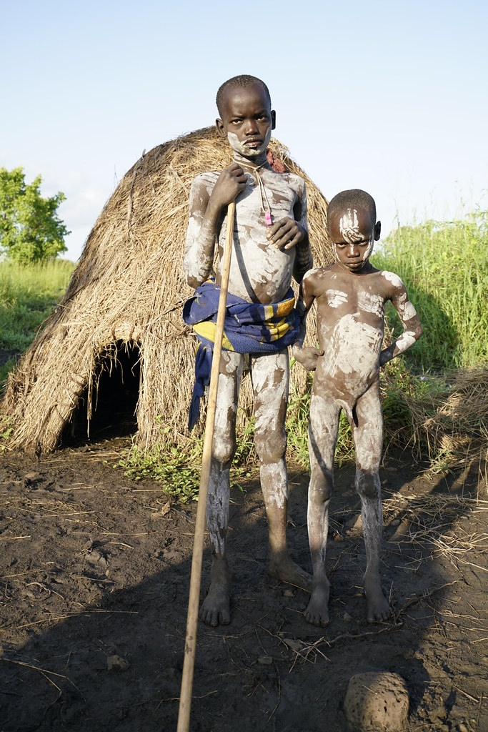 Ethiopia, South Omo Valley, Mursi Tribe, Young Boys With