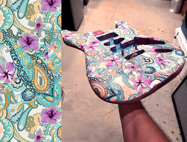 Steve-Schmitt-electric-guitar-covered-with-Hibiscus-Paisley-design-wallpaper