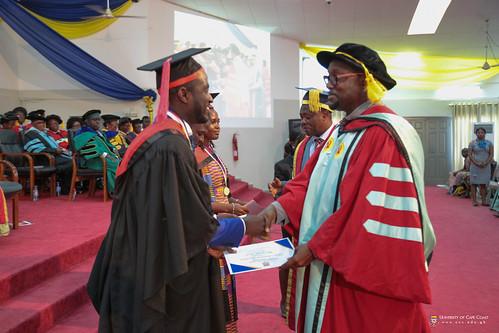 Prof. Ernest L. Okorley, Dean, School of Graduate Studies, presenting an award to a graduand.