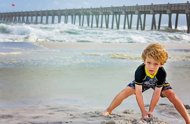 Boy makes sand castles on Pensacola Beach before Hurricane Michael