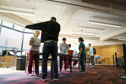 Nursing students perform free flu shots to faculty, staff and fellow students at the Health Sciences Student Faculty Center on Friday, October 12. | by Temple CPH
