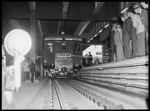 Opening of Circular Quay Station, official train just breaking through tapes | by NSW State Archives and Records