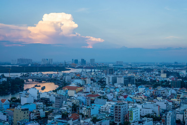 Sunset View of Ho Chi Minh City with Sun Reflection in the Water
