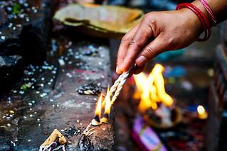 Burning Smudge sticks at Swayambhanath, Stupa in Kathmandu Nepal
