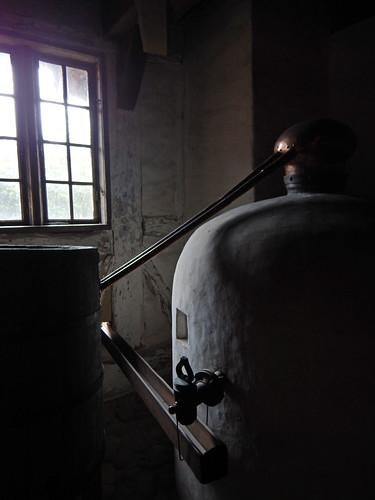 A brewery lit by a single window in Den Gamle By, a recreated historic village in Aarhus, Denmark