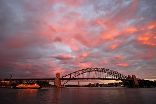 sydney harbour harbor bridge sunrise clouds new south wales australia