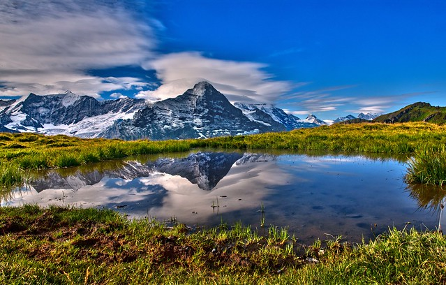 The Mighty  Eiger reflected in a puddle . Trift, Grindelwald. Canton of Bern. Switzerland.  Izakigur No. 3052. 27.08.18, 10:01:01 .