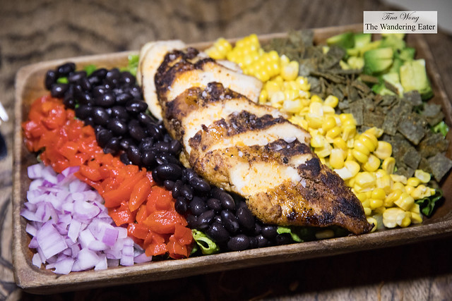 SXSW Salad - Spiced chicken breast, black beans, corn, roasted red bell peppers, avocado, serrano lime vinaigrette
