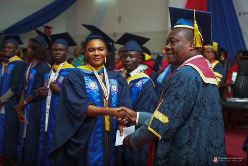 Prof. George K. T.  Oduro presenting an award to a graduand