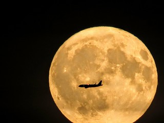 Harvest Moon 2018. An Airplane crossed the massive Harvest Moon that illuminates the dark sky.