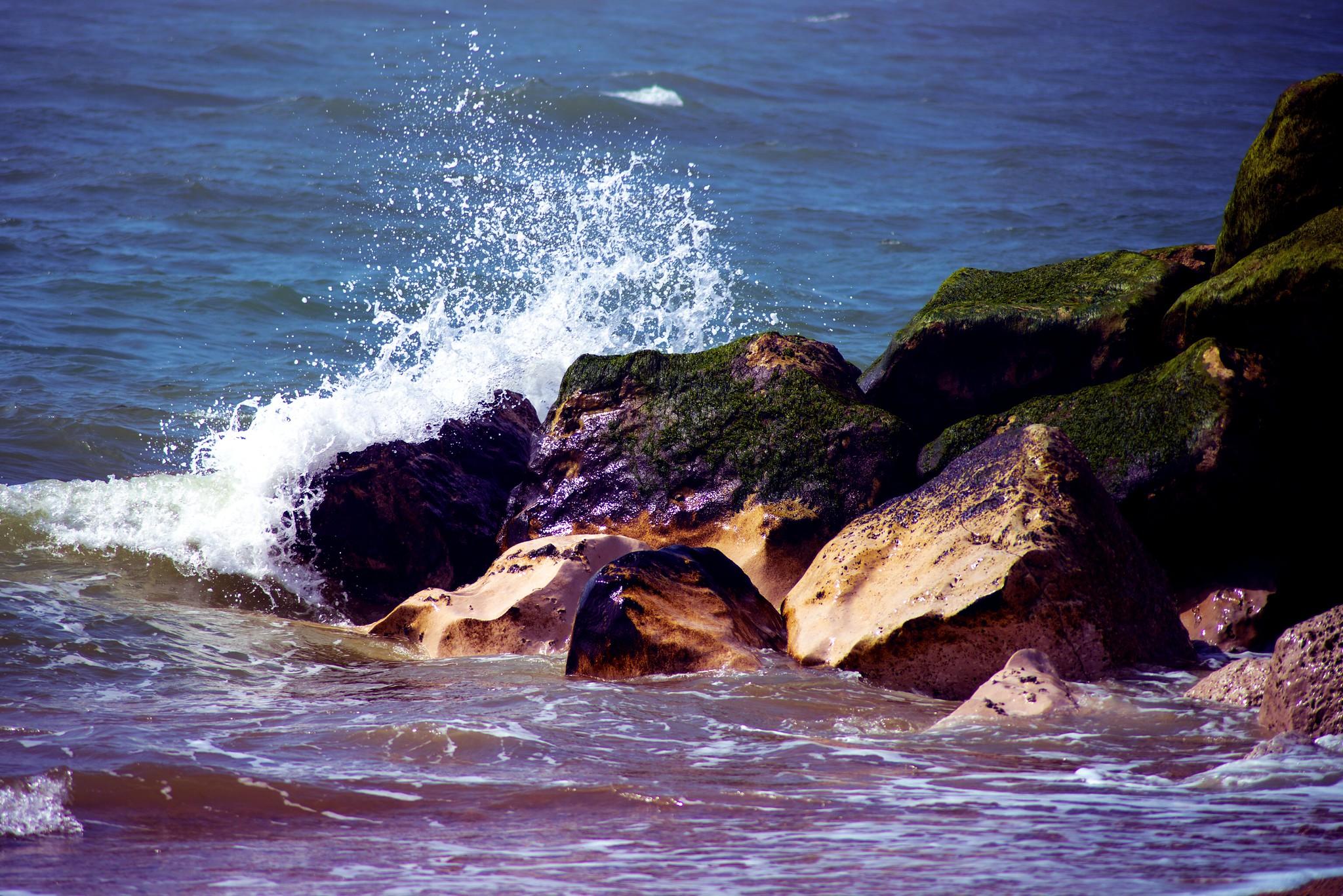 Small Wave Crashing Against Rocks