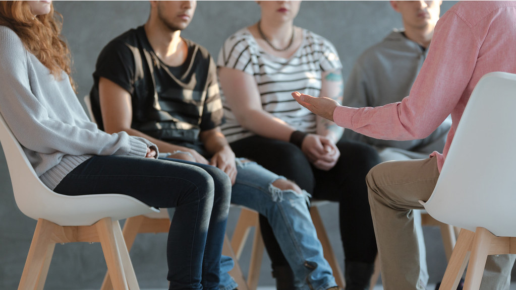 Group sitting in a therapy session