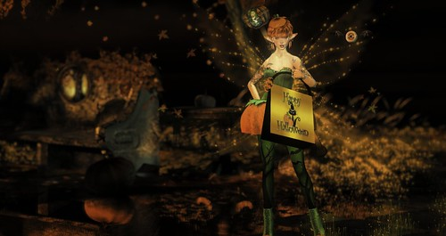 Trick or Treat!  I'm your friendly Halloween fairy this year!   Gimme all your candy or die!  Muah ha haaaaa....