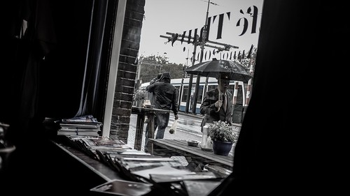 Amsterdam. Man with umbrella. Tram.