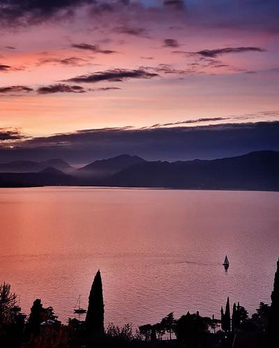Sunset @ garda lake #sunset #lake #gardasee #garda #violet #clouds #cloudy #sky #landscape #boat #sailing #landscape #view #photooftheday #picoftheday #igersitalia #igers #igersgarda #beautiful #life #family #mountains | by Mario De Carli