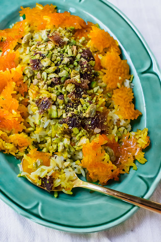 Persian rice with dates, chopped pistachios and aromatic cardamom is steamed together with an additive and crunchy saffron crust called tahdig. | by FerraroKitchen1