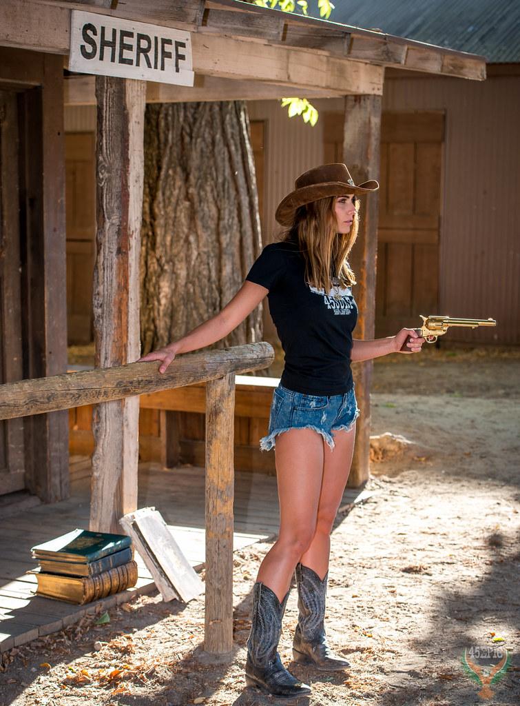 Beautiful Cowgirl Venus in Cowboy Boots Cowboy Hat Curoffs