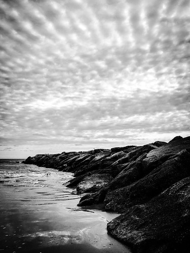 nydavid1234 beach jetty clouds sky shadows contrast monochrome blackandwhite rocks water sand ocean dark chiaroscuro autumn