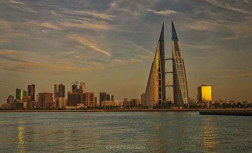 manama bahrain bay world trade centre city skyline glass water reflections highrise skyscraper sunset golden hour dxo photolab on1 affinity photo pentax k1 2470mm f28 wide angle